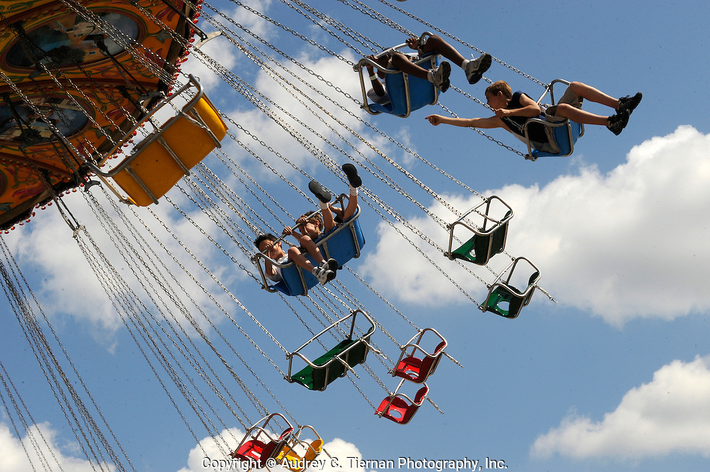 Uniondale, NY: June 28, 2009--- Children enjoy an amusement ride at the Nassau County fair on Long Island. © Audrey C. Tiernan
