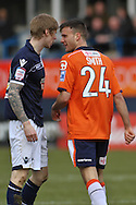 Picture by David Horn/Focus Images Ltd +44 7545 970036.16/02/2013.Jonathan Smith (right) of Luton Town and Andrew Keogh of Millwall exchange words early on during the The FA Cup match at Kenilworth Road, Luton.