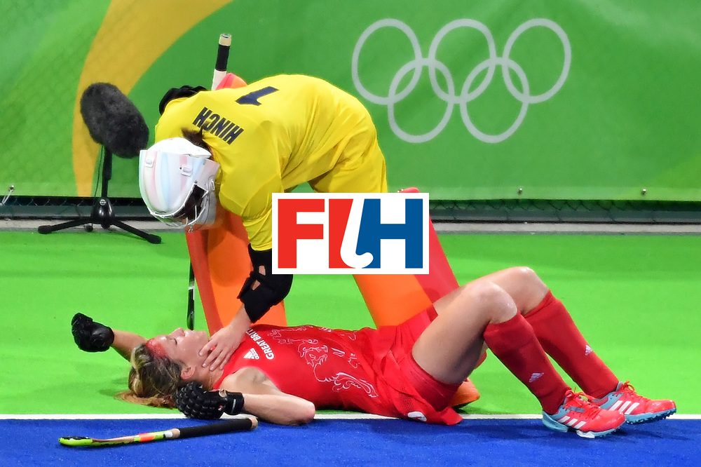 Britain's Crista Cullen (bottom) lies on the field after resulting injuried during the women's semifinal field hockey New Zealand vs Britain match of the Rio 2016 Olympics Games at the Olympic Hockey Centre in Rio de Janeiro on August 17, 2016. / AFP / Pascal GUYOT        (Photo credit should read PASCAL GUYOT/AFP/Getty Images)