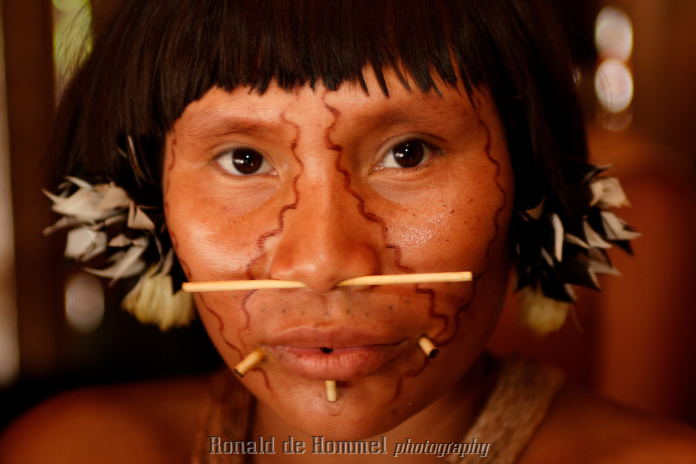 Viriunaveteri, Venezuela. A Yanomami woman..The village of Viriunaveteri consists of 15 huts around a muddy square. It's situated in the Venezuelan Amazone several days by boat from the nearest town. This community on the banks of the Casiquiare is one of the few Yanomami villages that actually has some contact with the outside world. Most other tribes live deeper in the jungle.