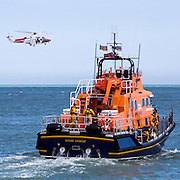 The Royal National Lifeboat Institution RNLI Dover Life boat (17-09),  HM Coastguard rescue helicopter (G-C1JW) take part in a joint training exercise in in the sea outside Folkestone Harbour, Folkestone, Kent. UK. 6th August 2016 (photo by Andrew Aitchison / In pictures via Getty Images)