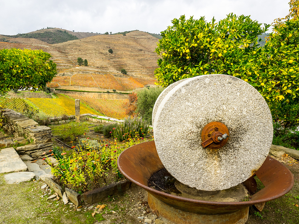Old olive press, plus one of stone plinth markers dating to original demarcation of the Douro region in 1756