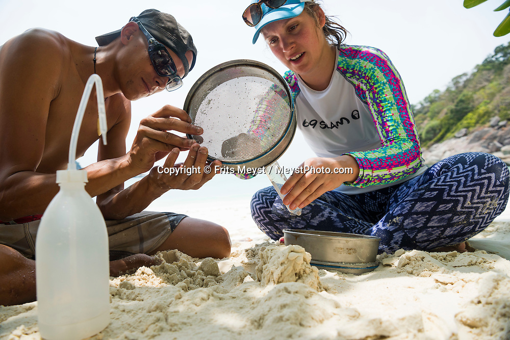 Boulder Island, Mergui Archipelago, Myanmar, April 2016.  Manuel Marinelli of project Manaia sifts the sand to take samples of microplastics. Project Manaia researches the Mergui Archipelago, Myanmar to help protect this remote island group for future generations and keep it as pristine as it is now. Manaia aims to provide a platform for independent scientists as well as camera teams to get them on the location for documentation and scientific work on Climate change issues, ocean acidification, plastic gyres and others. Photo by Frits Meyst / MeystPhoto.com