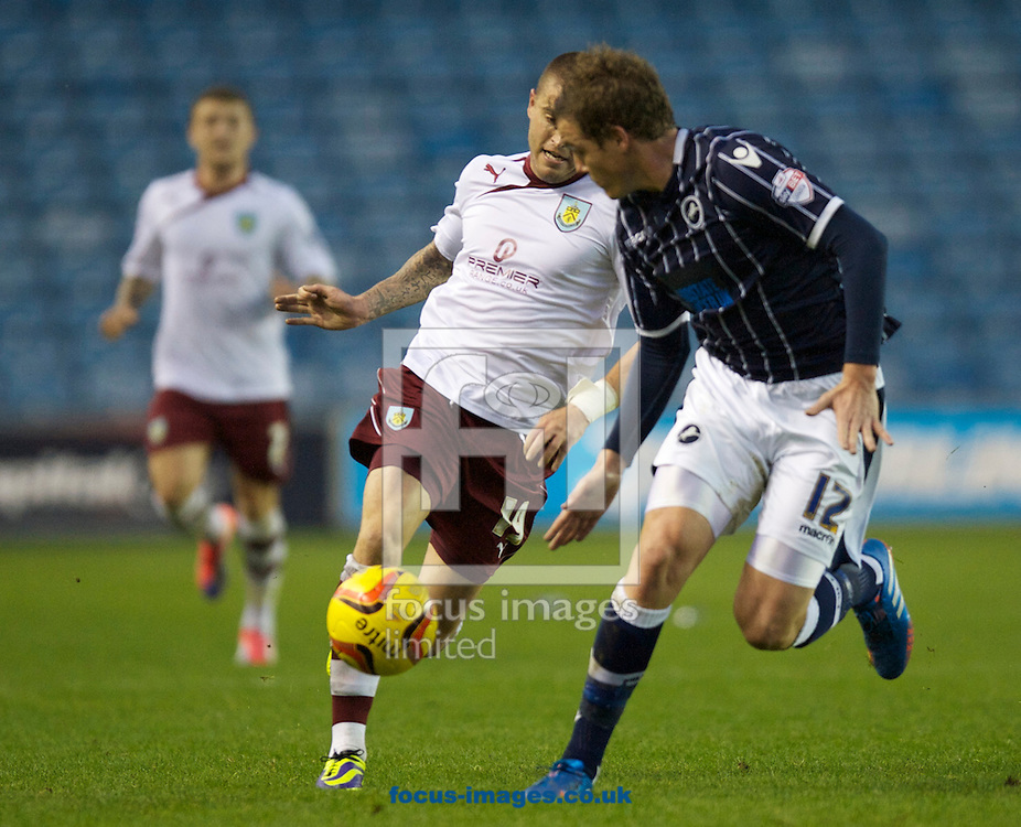 Picture by Alan Stanford/Focus Images Ltd +44 7915 056117<br /> 02/11/2013<br /> Shane Lowry of Millwall and Michael Kightly of Burnley during the Sky Bet Championship match at The Den, London.