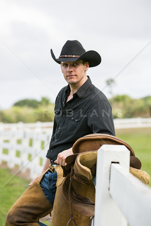 handsome cowboy outdoors on a ranch