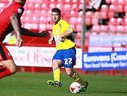 Accrington Stanley defender Adam Buxton plays a through ball during the Sky Bet League 2 match between Crawley Town and Accrington Stanley at the Checkatrade.com Stadium, Crawley, England on 26 September 2015. Photo by Bennett Dean.