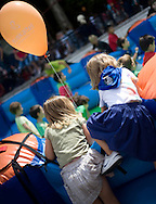 Two little girls play in an inflate castle during the Aste Nagusia festivities in the Northern Spanish Basque city of Bilbao, on August 25, 2011. Photo Rafa Rivas