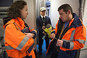 Inspectors Emmanuel and  Nesrine on the airport Roissy Charles de Gaule near Paris. With one order, they can immobilise a Boeing or delay the taking off for 300 passengers on an intercontinental flight. When Operating Technical Inspectors (CTE) get aboard , it is always in pairs and always unexpected. That day, Emmanuel Lain&eacute; (R) and Nesrine Chkioua (L), one of the only three women in France to do this job, control an international flight to Taipei and a cargo plane bound for Lebanon.<br /> <br /> D&rsquo;un ordre, ils peuvent immobiliser un Boeing ou retarder le d&eacute;collage des 300 passagers d&rsquo;un long courrier. Quand les contr&ocirc;leurs techniques d&rsquo;exploitation (CTE) d&eacute;barquent, c&rsquo;est toujours en bin&ocirc;me et toujours &agrave; l&rsquo;improviste. Ce jour-l&agrave;, Emmanuel Lain&eacute; (D) et Nesrine Chkioua (G), l&rsquo;une des 3 femmes CTE en France, passent au crible un vol international pour Taipei et un