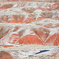 Snow covered Painted Desert, Petrified National Park, AZ