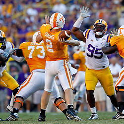 Oct 2, 2010; Baton Rouge, LA, USA; LSU Tigers defensive tackle Lazarius Levingston (95) pressures Tennessee Volunteers quarterback Matt Simms (2) during the second half at Tiger Stadium. LSU defeated Tennessee 16-14.  Mandatory Credit: Derick E. Hingle