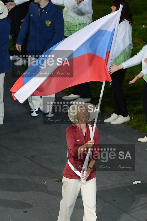 LONDON, ENGLAND - JULY 27, Maria Sharapova of Russia, carries the Russian flag during London Olympics Opening Ceremony at the Olympic Stadium on July 27, 2012 in London, England.Photo by Roger Sedres / Gallo Images