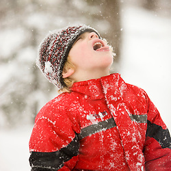 A young boy catches snowflakes with his mouth during a snowstorm in Portsmouth, New Hampshire.
