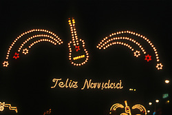 Illuminated neon sign featuring a guitar and saying 'Feliz Navidad'  Happy Christmas,