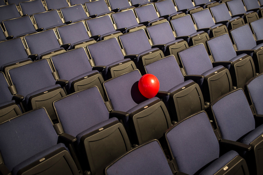 A lone red balloon sits in the stands at the Republican National Convention on Friday, August 24, 2012 in Tampa, FL.