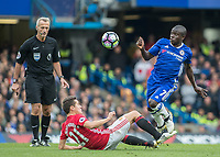 Football - 2016/2017 Premier League - Chelsea V Manchester United<br /> <br /> Ngolo Kante of Chelsea leaps over the sliding tackle of Ander Herrera of Manchester United at Stamford Bridge.<br /> <br /> COLORSPORT/DANIEL BEARHAM