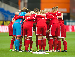 CARDIFF, WALES - Tuesday, August 21, 2014: The Welsh team have a team talk prior to kick against England during the FIFA Women's World Cup Canada 2015 Qualifying Group 6 match at the Cardiff City Stadium. (Pic by Ian Cook/Propaganda)