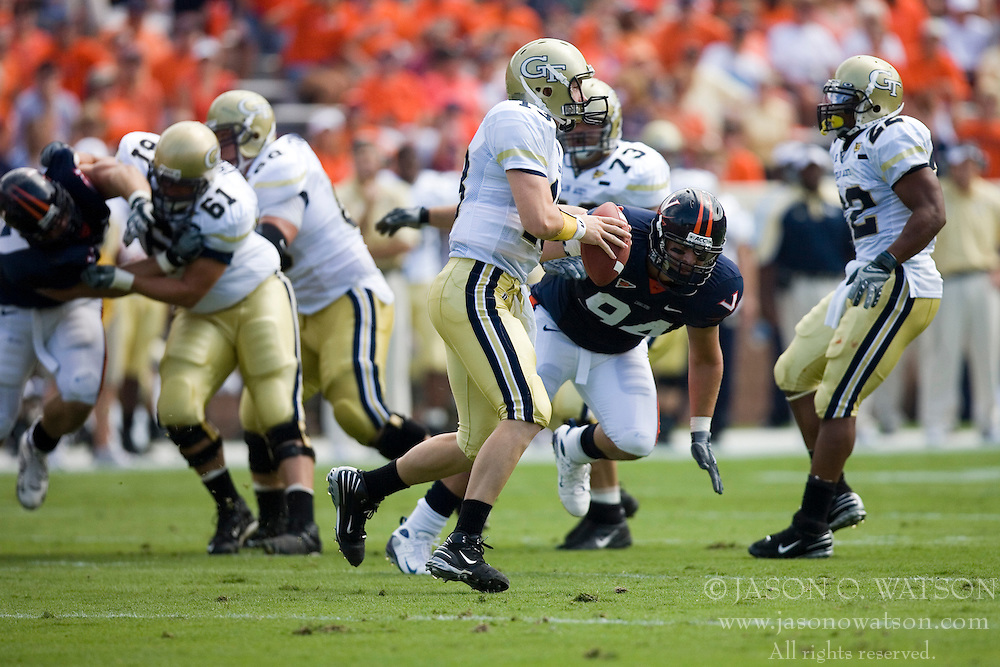 Virginia NT Allen Billyk (94) puts pressure on Georgia Tech quarterback Taylor Bennett (13).  The Virginia Cavaliers football team faced the Georgia Tech Yellow Jackets at Scott Stadium in Charlottesville, VA on September 22, 2007.