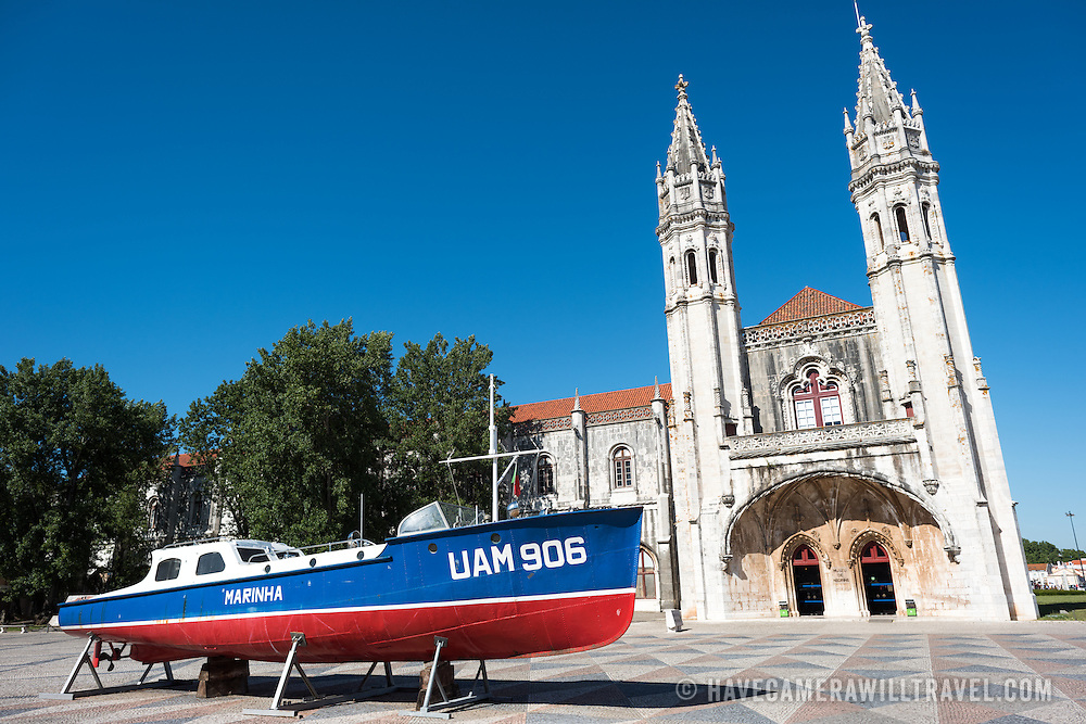The main entrance of the Museu de Marinha (Maritime Museum). The entrance is through the original 15th century chapel. The Museu de Marinha (Maritime Museum of Navy Museum) focuses on Portuguese maritime history. It features exhibits on Portugal's Age of Discovery, the Portuguese Navy, commercial and recreational shipping, and, in a large annex, barges and seaplanes. Located in the Belem neighborhood of Lisbon, it occupies, in part, one wing of the Jerónimos Monastery. Its entrance is through a chapel that Henry the Navigator had built as the place where departing voyagers took mass before setting sail. The museum has occupied its present space since 1963.