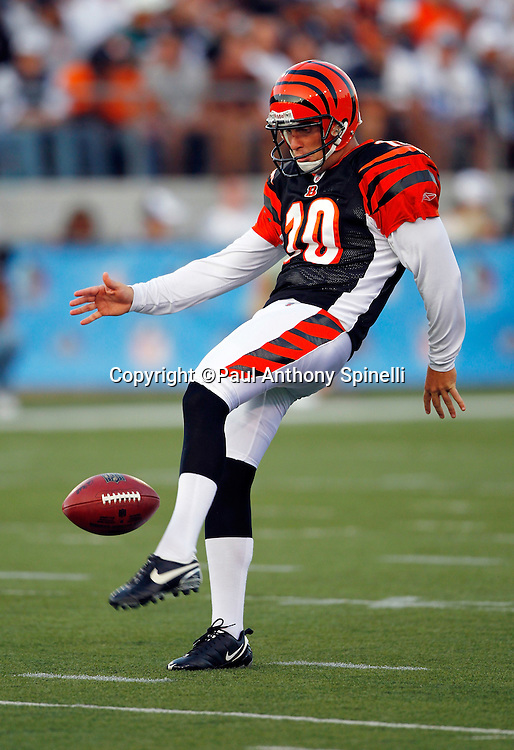 Cincinnati Bengals punter Kevin Huber (10) punts during the NFL Pro Football Hall of Fame preseason football game between the Dallas Cowboys and the Cincinnati Bengals on Sunday, August 8, 2010 in Canton, Ohio. The Cowboys won the game 16-7. (©Paul Anthony Spinelli)