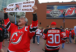 May 30; Newark, NJ, USA; A New Jersey Devils fan holds up a sign before the 2012 Stanley Cup Finals Game 1 at the Prudential Center.  The Kings defeated the Devils 2-1.