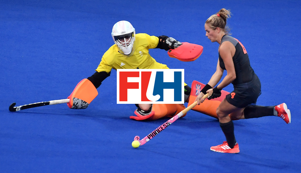 Netherlands' Kitty van Male (R) runs past Britain's goalkeeper Maddie Hinch to score a goal during the women's Gold medal hockey Netherlands vs Britain match of the Rio 2016 Olympics Games at the Olympic Hockey Centre in Rio de Janeiro on August 19, 2016. / AFP / Pascal GUYOT        (Photo credit should read PASCAL GUYOT/AFP/Getty Images)