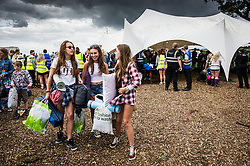 Festivalgoers arriving at the Brownstock Festival in Essex.