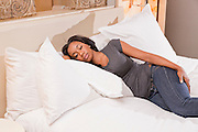 Young African American Woman resting in a bed
