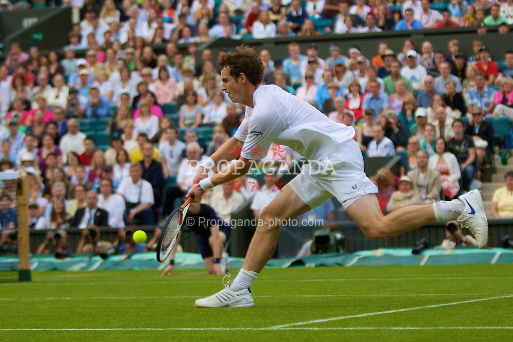 LONDON, ENGLAND - Tuesday, June 24, 2008: Andy Murray (GBR) plays his match-winning shot during his first round victory day two of the Wimbledon Lawn Tennis Championships at the All England Lawn Tennis and Croquet Club. (Photo by David Rawcliffe/Propaganda)