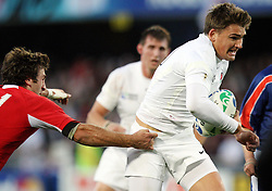 England's Toby Flood, right, in the gasp of Georgia's Alexander Todua in the Rugby World Cup pool match at Otago Stadium, Dunedin, New Zealand, Sunday, September 18, 2011. Credit:SNPA / Dianne Manson.