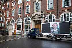 London, UK. 6 December, 2019. A screen positioned outside Conservative party HQ, organised by campaign group Led By Donkeys, relays broadcast journalist Andrew Neil's challenge to Prime Minister Boris Johnson to submit himself to the scrutiny of a detailed interview with him prior to the general election, as have all other party leaders. To date, the Prime Minister has failed to accept all such requests from Andrew Neil.