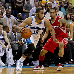 April 19, 2012; New Orleans, LA, USA; New Orleans Hornets shooting guard Eric Gordon (10) is defended by Houston Rockets shooting guard Courtney Lee (5) during the second half at the New Orleans Arena. The Hornets defeated the Rockets 105-99.   Mandatory Credit: Derick E. Hingle-US PRESSWIRE