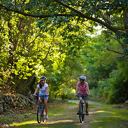 Two women biking at Odiorne State Park in Rye, New Hampshire.