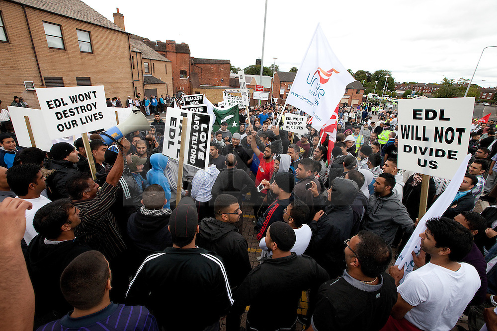 © Licensed to London News Pictures. 13/08/2011. Telford, UK. A demonstration to oppose the EDL in Wellington. The EDL demonstrate against a paedophile ring in the small Telford town of Wellington. The group were going to march, however the Home Secretary imposed a ban on all marches in the area. About 300 EDL supporters attended. The EDL demonstration was counter-protested by about 300 people. Photo credit : Joel Goodman/LNP