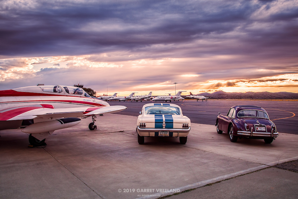 Delfin, Mustang and Jaguar Tableau at sunset, Planes and Cars at the Santa Fe Airport, 2013 Santa Fe Concorso.