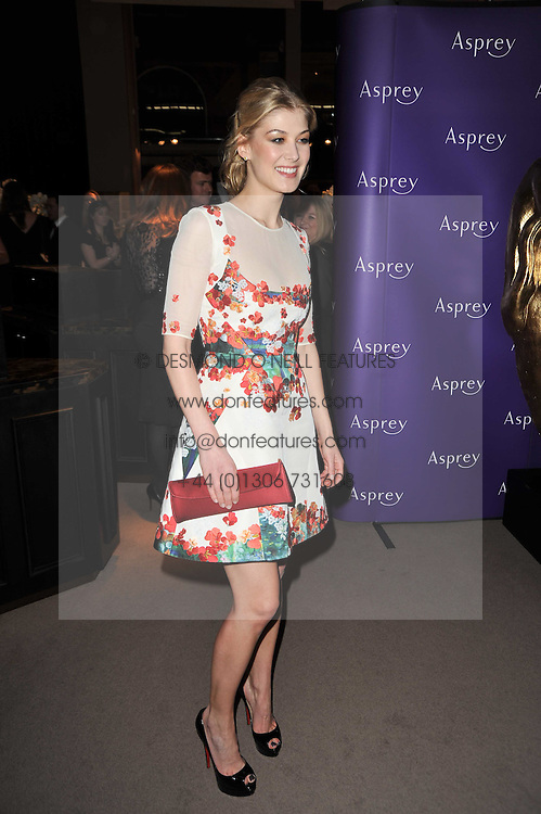 ROSAMUND PIKE at the BAFTA Nominees party 2011 held at Asprey, 167 New Bond Street, London on 12th February 2011.