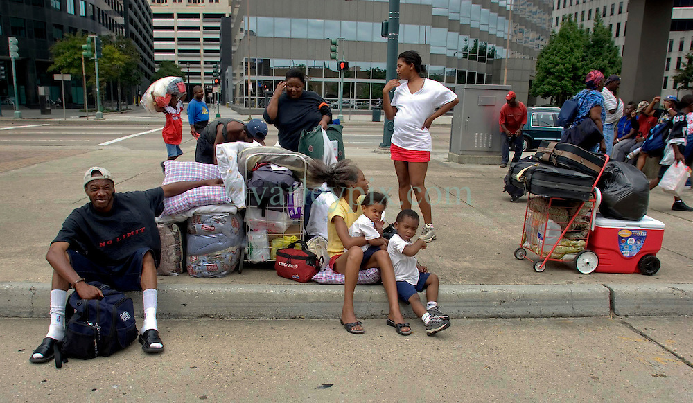 28th August, 2005. Hurricane Katrina, New Orleans, Louisiana. A family waits with all their belongings for a place in the Superdome.
