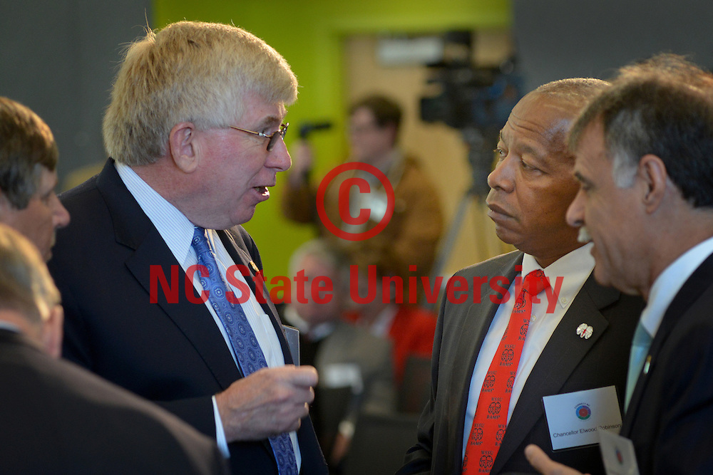 NC state senator Tom McInnis (left) and Winston Salem State University chancellor Elwood Robinson (right) chat prior to the start of the Connect NC campaign kick-off at Hunt Library on NC State's Centennial Campus.