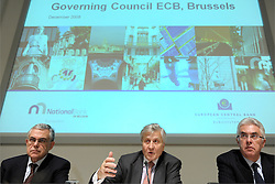 Jean-Claude Trichet, president of the European Central Bank, center, speaks while Lucas D. Papademos, vice president of the European Central Bank, left, and Guy Quaden, governor of the Belgian National Bank, listen during a news conference at the National Bank of Belgium, in Brussels, Thurdsday, Dec. 4, 2008. (Photo © Jock Fistick)..