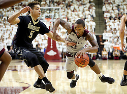 Texas A&M's Anthony Collins (11) drives the lane against Vanderbilt's Matthew Fisher-Davis (5) during the first half of an NCAA college basketball game, Saturday, March 5, 2016, in College Station, Texas. (AP Photo/Sam Craft)