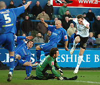 Photo: Paul Greenwood.<br />Macclesfield Town v Hereford United. Coca Cola League 2. 20/01/2007. Macclesfield goalkeeper Tommy Lee saves bravely from Hereford's Alex Jeannin, right.