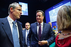 © Licensed to London News Pictures. 06/10/2015. Manchester, UK. Conservative's London Mayor candidate Zac Goldsmith and Prime Minister David Cameron listening Mayor of London Boris Johnson's speech at Conservative Party Conference at Manchester Central on Tuesday, 6 October 2015. Photo credit: Tolga Akmen/LNP