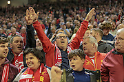 Liverpool fans celebrate scoring the equaliser in injury time. 1-1 during the Barclays Premier League match between Liverpool and Chelsea at Anfield, Liverpool, England on 11 May 2016. Photo by Mark P Doherty.
