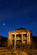 Stars and the planet Venus, at left, shine over an abandoned building at the former Middletown Psychiatric Center on April 15, 2015.