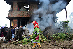 May 24, 2019 - Srinagar, Kashmir - Kashmiri People assess the damaged residential house where top rebel leader Zakir Musa was killed in a gun battle with Indian Government Forces in Dadsara area of Pulwama District, Indian Administered Kashmir on 24 May 2019. Musa was killed in an overnight encounter with Indian Governmnet Forces in Dadsara Village of pulwama ditrict. Musa was associated with Al-Qaida wing in Kahsmir and was the head of self formed rebellion group Ansar Gazwatul Hind. (Credit Image: © Muzamil Mattoo/NurPhoto via ZUMA Press)