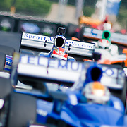 James Hinchcliffe #06 (middle) coming out of turn number 8 in the middle of the pack at the inaugural Baltimore Grand Prix Sunday Sept. 4, 2011 in Baltimore Maryland.