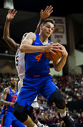 Florida guard Egor Koulechov (4) pulls a loose ball away from Texas A&M guard Savion Flagg (5) during the first half of an NCAA college basketball game Tuesday, Jan. 2, 2018, in College Station, Texas. (AP Photo/Sam Craft)