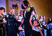 Marilyn Mosby leads her children, Nylyn, 6 (left,) and a reluctant Aniyah, 4 onto the grandstand past Mayor Stephanie Rawlings-Blake and Baltimore Police Commissioner  Anthony Batts. Inauguration of Marilyn J. Mosby as State's Attorney for Baltimore at the War Memorial in Baltimore. Onleya few months later she would be on the national stage as the Freddie Gray unrest roiled Baltimore, and led to the arrest and prosecution of six police officers in the fatal injury of Gray while in police custody. Batts was later relieved of his duties over the Freddie Gray case and Rawlings-Blake has announced she will not run for mayor again.
