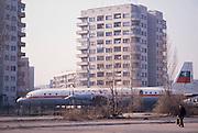 November 18, 1989. Sofia, Bulgaria. A retired Iljushin Il-18 passenger plane serves as a playground between typical concrete blocs. (Photo Heimo Aga)