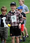 Cricket Fan Ruben Cook about to bowl at the National Bank's Cricket Super Camp , University oval, Dunedin, New Zealand. Thursday 2 February 2012 . Photo: Richard Hood photosport.co.nz