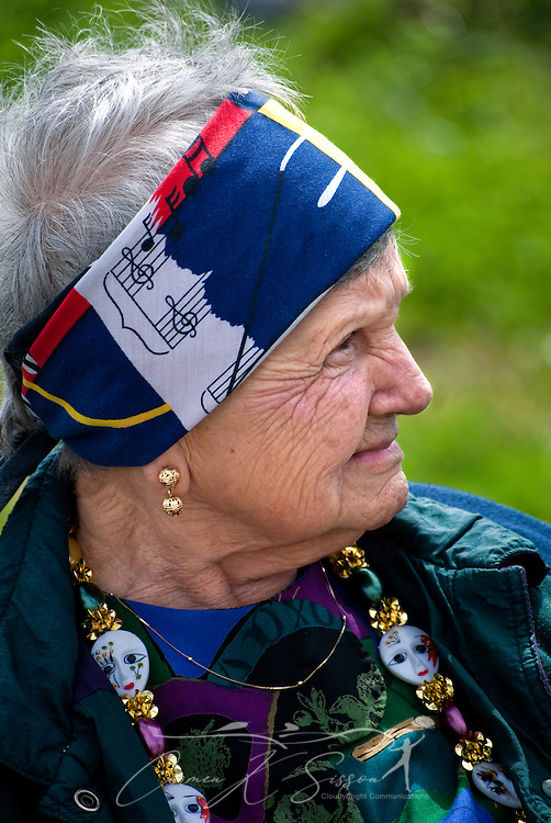 Inez Swenson, 89, smiles as she watches the annual Mardi Gras parade March 6, 2011 in Grand Isle, La. The island was heavily impacted by the Deepwater Horizon oil spill April 20, 2010 and continues to recover. (Photo by Carmen K. Sisson/Cloudybright)